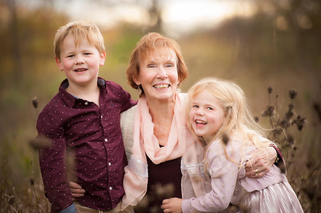 A happy grandmother with her grandson and grandaughter.